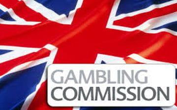 Il logo della Gambling Commission con la bandiera del Regno Unito sullo sfondo