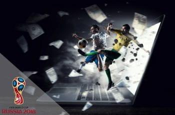 Alcuni giocatori di calcio delle Nazionali presenti a Russia 2018 con sullo sfondo un computer portatile