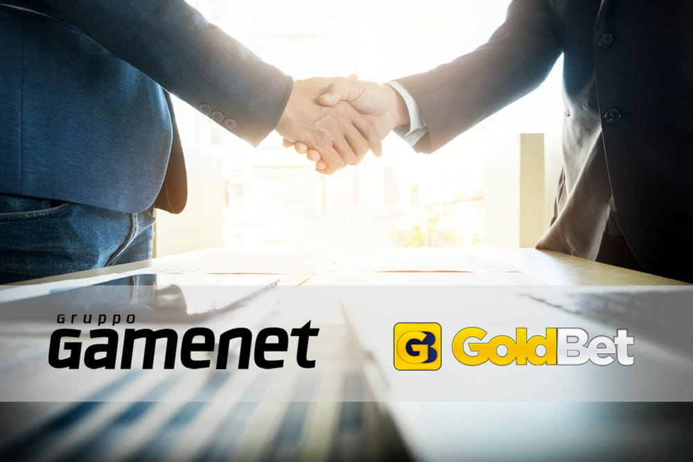 Stretta di mano per accordo acquisizione Gamenet-Goldbet