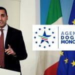 Il Ministro del Lavoro Luigi Di Maio, le bandiere di Italia e Europa e il simbolo dell'Agenzia Dogane e Monopoli