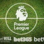 Il cerchio di centrocampo di un campo da calcio e i loghi della Premier League, di William Hill, bet365 e Betway