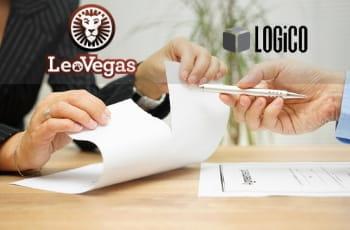 I loghi di LeoVegas e LOGICO, e delle mani attorno alla scrivania di un tavolo d'ufficio che strappano un foglio di carta, mentre un uomo porge una penna