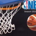 Palla da basket, un canestro e il logo NBA della stagione 2018-2019
