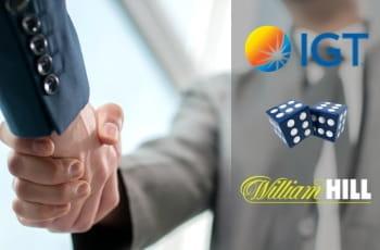 La stretta di mano tra due persone, due dadi da gioco e i loghi di IGT e William Hill