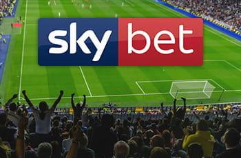Uno stadio affollato durante una partita di calcio e il logo di Sky Bet