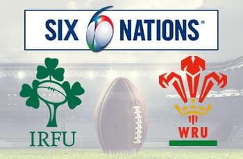 Uno stadio da rugby con una palla ovale in primo piano, e i loghi del torneo Sei Nazioni e delle federazioni di Irlanda e Galles
