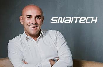 Fabio Schiavolin, AD di Snaitech, e il logo dell'azienda