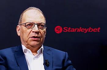 Giovanni Garrisi, CEO di Stanleybet, e il logo del bookmaker online