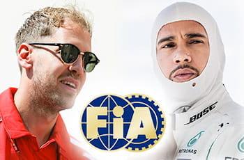 Sebastian Vettel, Lewis Hamilton e il logo della Fia