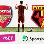 I loghi delle squadre di Premier League di Arsenal e Watford, I loghi dei bookmaker Sportsbet.io e VBet, un calciatore generico che esulta