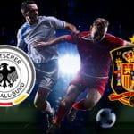Giocatori di calcio in azione e i loghi di Germania e Spagna