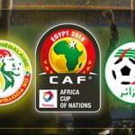 Il logo della Coppa d'Africa 2019, il badge della federazione calcistica del Senegal, il badge della federazione calcistica dell'Algeria
