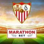 Il logo del Siviglia FC, il logo di Marathon Bet, uno stadio di calcio in sottofondo