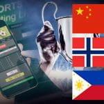 Una coppa, la schermata di un sito scommesse su uno smartphone e le bandiere di Cina, Norvegia e Filippine