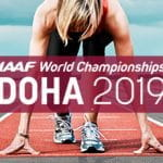 Una atleta ai blocchi di partenza e il logo dei Campionati Mondiali di atletica 2019