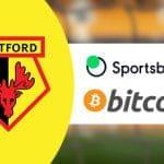 La bandiera del Regno Unito e i loghi di Watford FC, sportsbet.io, bitcoin