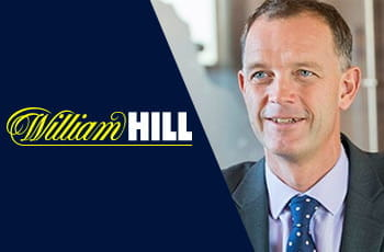 Il logo di William Hill e il CEO dimissionario Philip Bowcock