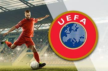 Un calciatore in azione e il logo della UEFA