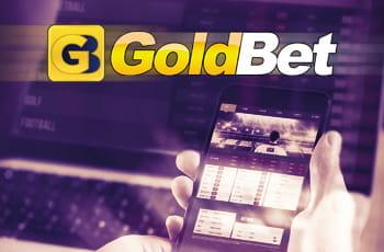 Il logo di GoldBet, uno smartphone con un sito di scommesse