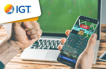 Il logo del gruppo IGT, uno smartphone connesso ad un sito di scommesse
