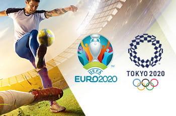 Un calciatore in azione e i loghi degli Europei di calcio 2020 e delle Olimpiadi 2020