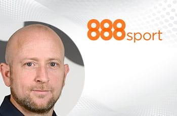 Itai Pazner, CEO di 888 Holdings, e il logo di 888sport