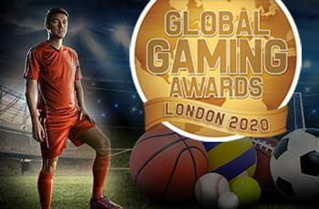 Un atleta, palle da gioco di vari sport e il logo dei Global Gaming Awards 2020 di Londra
