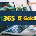 Un laptop e i loghi di bet365 e GoldBet