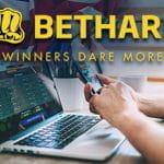 Un laptop e uno smartphone e il logo di Bethard