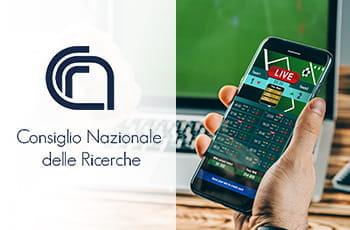 La piattaforma di un bookmaker su uno smartphone e il logo del CNR