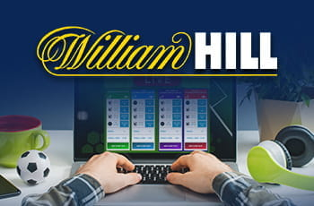 Una persona davanti a un laptop e il logo di William Hill