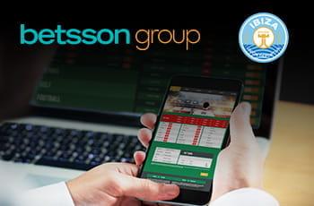 I loghi di Betsson, dell'UD Ibiza e uno smartphone collegato a un sito scommesse online