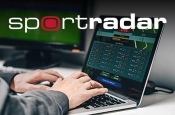 Il logo di Sportradar e un laptop