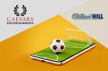 I loghi di Caesars Entertainment e William Hill e un campo di calcio stilizzato sullo schermo di uno smartphone