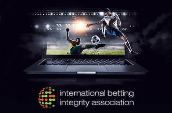 Il logo dell'IBIA e dei calciatori in azione