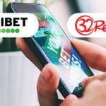 I loghi di Unibet e 32Red e uno smartphone collegato al sito di un bookmaker online