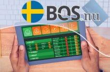 La bandiera svedese, il logo di BOS e un tablet collegato a un bookmaker online