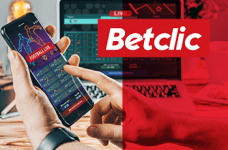 Il logo di Betclic e uno smartphone collegato a un bookmaker online