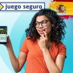 Il logo della DGOJ, ente regolatore del gioco in Spagna, e una ragazza con uno smartphone