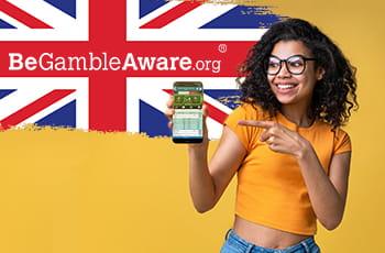 Il logo di GambleAware, la bandiera del Regno Unito e una ragazza con uno smartphone