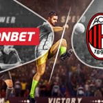 Il logo del bookmaker Fonbet e il logo del Milan