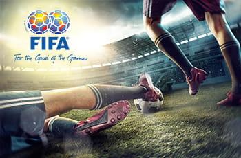 Il logo della FIFA e dei calciatori in azione