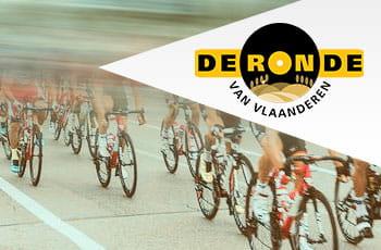 Il logo del Giro delle Fiandre e un gruppo di ciclisti in azione
