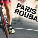 Il logo della Parigi-Roubaix e un ciclista in azione sul pavé