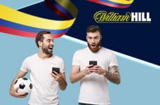 Il logo di William Hill, la bandiera della Colombia e due ragazzi con uno smartphone