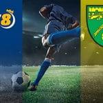 I loghi di BK8 e del Norwich e un calciatore in azione