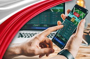 Uno smartphone collegato a un sito scommesse online e i colori della bandiera polacca