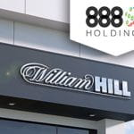 Negozio con insegna William Hill e logo 888 Holdings.